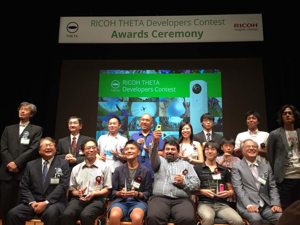 Back row, second from left: Makoto Igarashi, president of MTI