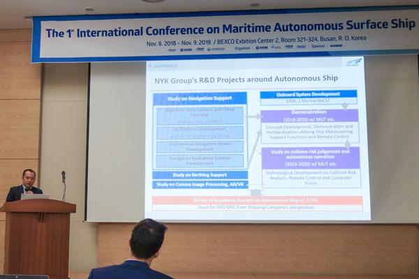 Capt. Koji Kutsuna, manager at MTI's Marine IT, during his presentation